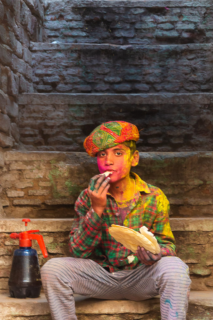 Am hungry..A local boy eating papad